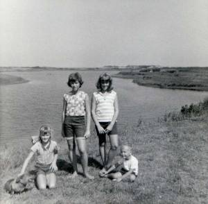 Four of us in front of the pond by the Quillan's cottage in August 1964. The ocean was a short walk over the bluff.